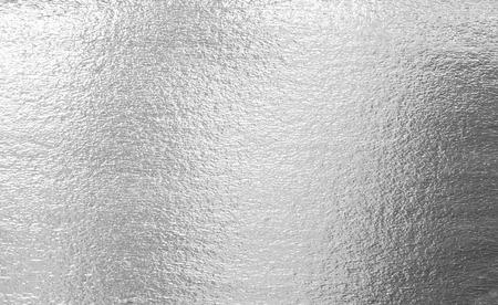 Glanzende zilveren folie abstracte patroon textuur als achtergrond