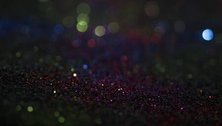 Bokeh glitter fly and lights on black background