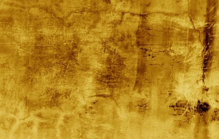 Old gold plaster wall texture yellow background