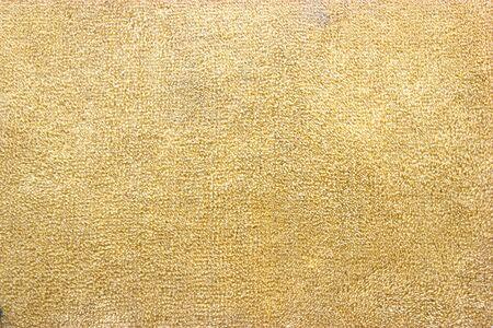 Generic seamless neutral brown orange carpet texture background.