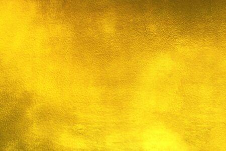 Fondo brillante di struttura della stagnola di oro della foglia gialla Archivio Fotografico