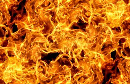 Flammes de feu sur un résumé de fond noir. Banque d'images