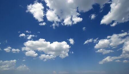 White clouds cumulus floating on blue sky for backgrounds concept