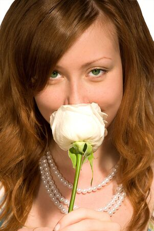 smells: The girl smells a rose