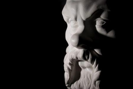 Socrates statue isolated on black background photo