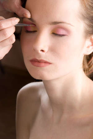 Stylist causes make up the beautiful model Stock Photo
