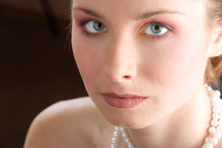 Beautiful model with green eyes looking into the camera photo