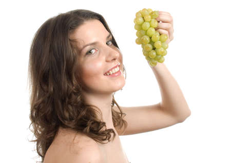 nudist young: Girl holds grapes isolated on a white background