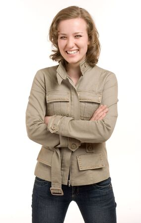 Young girl in khaki jacket on a white background photo