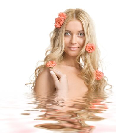 The portrait of a beautiful blond lady with pink roses in water on a white background