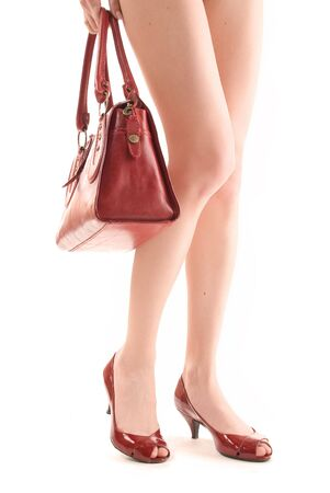 Red bag and shoes on a white background photo