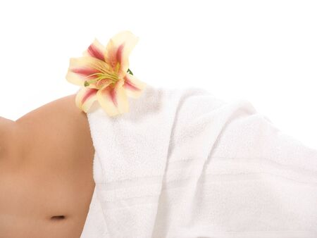 Woman in towel with lily isolated on white background Stock Photo - 3136872