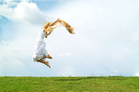 A young lady jumping on the background of the sky Stock Photo