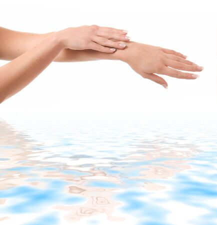 Womens hands in water isolated on a white background Stock Photo