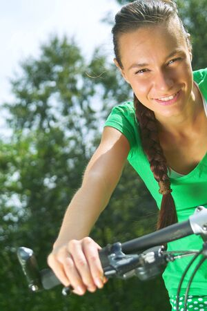 Active lady a bike ride in the park Stock Photo