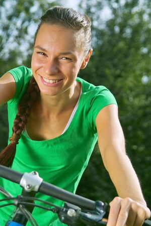 Active lady a bike ride in the park Stock Photo - 3438914