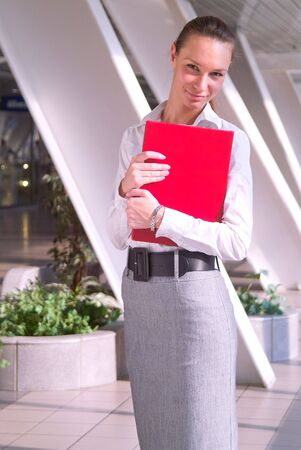 Portrait of beautiful young business woman with red folder Stock Photo - 3467955