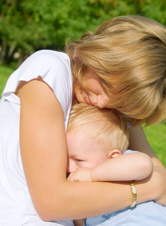 Mother and son rest in the park summer day Stock Photo - 3468026