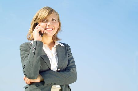 Beautiful young business woman speaks by phone Stock Photo - 3467948