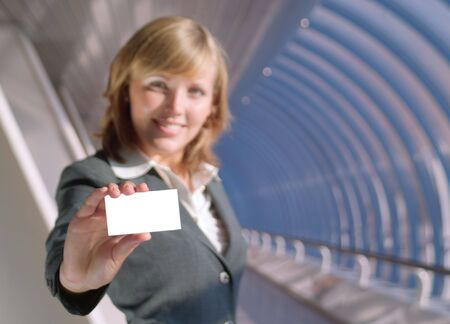 Beautiful lady holds a blank card (focus on card) photo