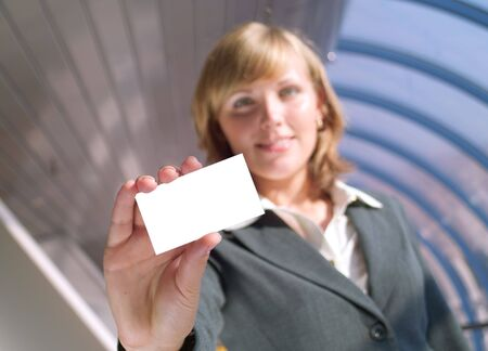 Beautiful lady holds a blank card (focus on card) Stock Photo - 3494547