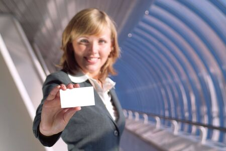 Beautiful lady holds a blank card (focus on card) Stock Photo - 3523734