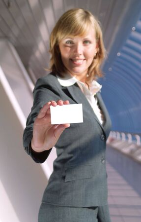 Beautiful lady holds a blank card (focus on card) Stock Photo - 3523737