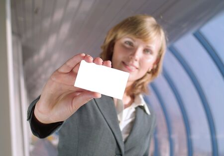 Beautiful lady holds a blank card (focus on card) Stock Photo - 3523712