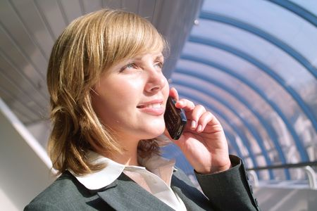 Beautiful young business woman speaks by phone photo