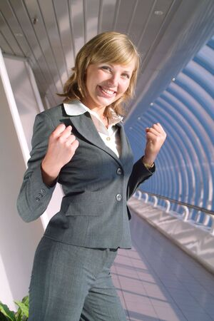 Portrait of successful business lady in grey suit