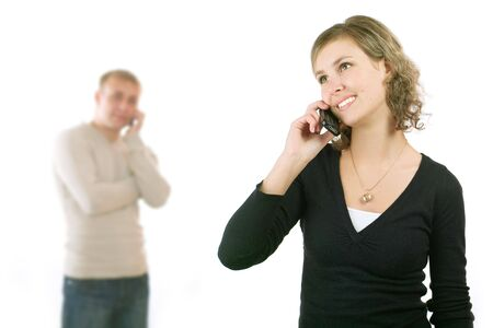 Couple talking on phone. Isolated on a white background. Stock Photo - 3730342