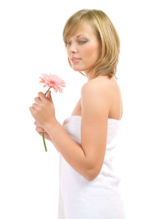 Portrait ob beautiful young lady with pink gerbera isolated on a white background photo