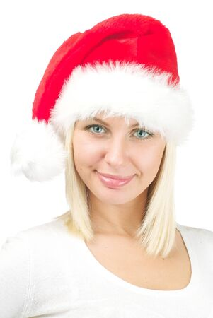 Portrait of beautiful woman in Santa`s hat on a white background. photo