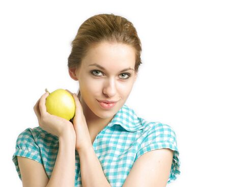 Portrait of young woman with apple on a white background photo