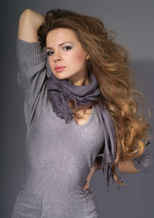 Portrait of beautiful young woman on a grey background Stock Photo