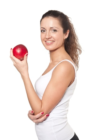 한 사람 만: 흰색 배경에 빨간 사과와 웃는 여자의 스튜디오 촬영