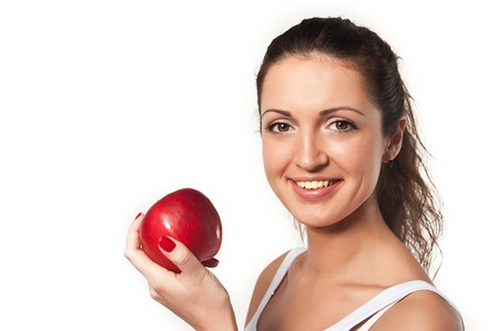 studio shoot: Studio shoot of smiling woman with red apple on a white background