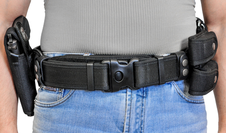 Military tactical belt with semi-automatic buckle for connection with cartridge pouch, placed on mans belt, isolated - front view