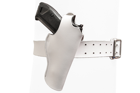 White leather two prong belt with a gun in a molded holster, close up, isolated