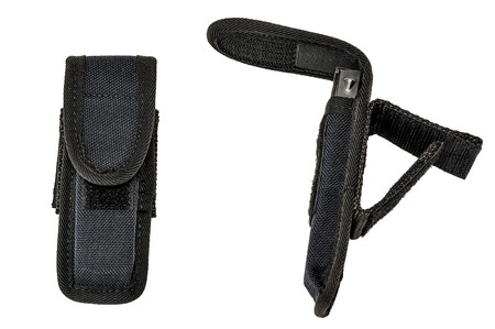 Carrying weapons case: military tactical cartridge pouch made from high-tech fabric with quick connection system, close up, isolated Stock Photo