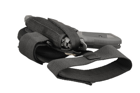gat: The gun in the tactical on-shin holster. Isolated Stock Photo