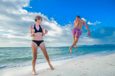 Remember the childhood: a couple of thirty-year-olds jumping and running along the beach, fighting and doing a handstands, laughing and having fun