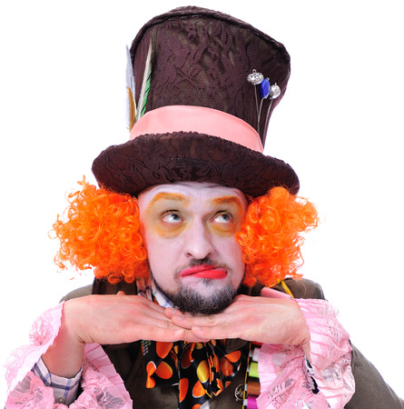 Mad hatter's different facial emotions. Close-up portrait of smiling and fooling around animator in various theater roles. Emotional and colorful Stock Photo