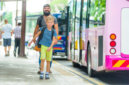 Father and son happy and excited together for the trip to Kuala Lumpur. Making a city tour. Holiday vacation, traveling abroad concept, copy space Stock Photo