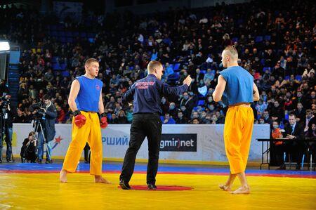 KIEV, UKRAINE - DECEMBER, 16, 2015: Ukrainian Combat Games III - nationwide Combat Games - fight of Ukrainian free-fight-athletes for the Champion title