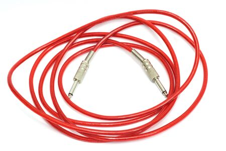 monophonic: Electric guitar patch cable isolated on white