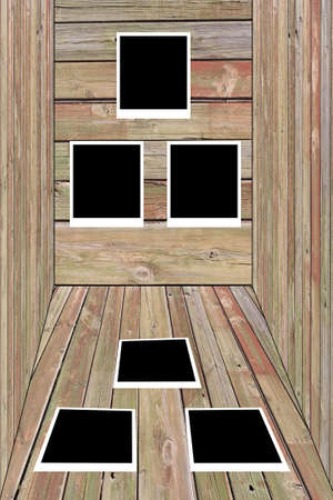 set of six old blank polaroids frames lying on a wood surface  photo