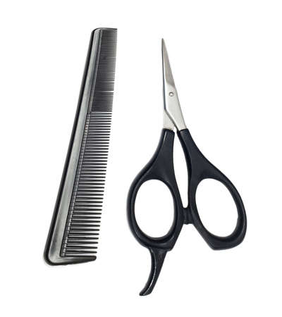 Scissors and comb isolated on white background Stock Photo - 9333133