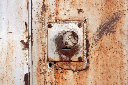 Old padlock on garage collars  Stock Photo - 9333421
