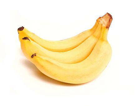 fruited: three mature bananas on white background Stock Photo